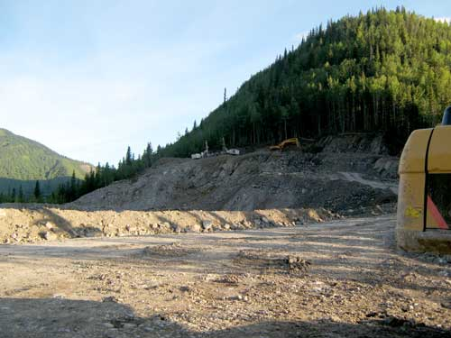 Nahanni Construction working with the drill rigs in the pine pass